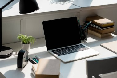 close-up shot of modern workplace with laptop at home