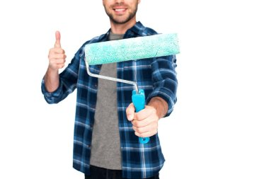 cropped image of man doing thumb up gesture and holding paint roller isolated on white background