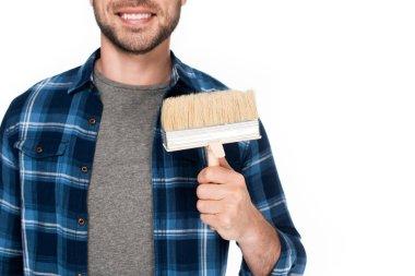 cropped image of happy man holding paint brush isolated on white background