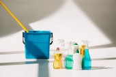 Fotografie various cleaning products, mop and bucket on white
