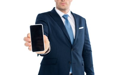 cropped shot of businessman holding smartphone with blank screen isolated on white