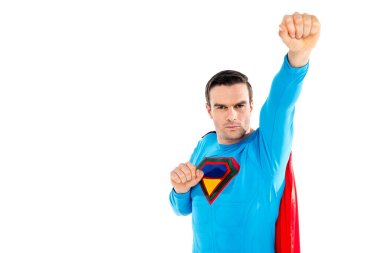 handsome male superhero raising hand and looking at camera isolated on white
