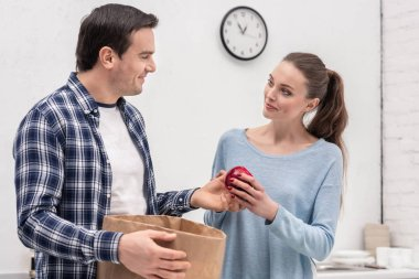 beautiful adult couple unpacking buys after grocery shopping