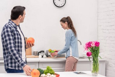 beautiful adult couple spending time together at kitchen