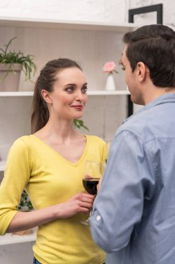 beautiful adult couple drinking wine and looking at each other