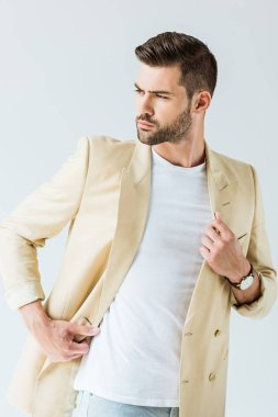 Fashionable confident man posing in beige jacket isolated on white background stock vector