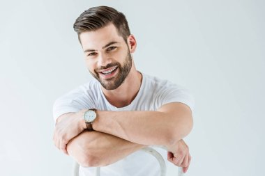 Fashionable confident man smiling while sitting on chair isolated on white background stock vector