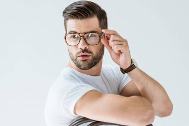 Fashionable confident man fixing his glasses isolated on white background stock vector