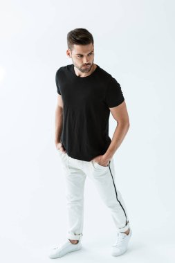 Stylish young man in black t-shirt posing on white background