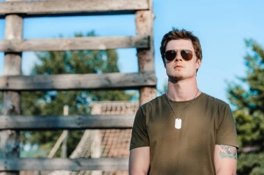 portrait of young soldier in sunglasses on range
