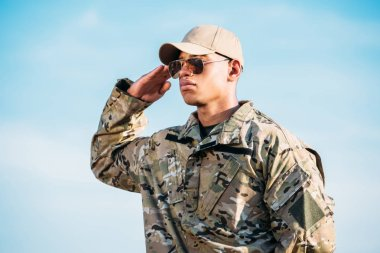 portrait of african american soldier in military uniform, cap and sunglasses