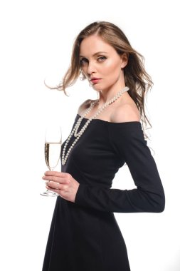 elegant woman in black dress holding champagne glass isolated on white background