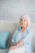 Fotografie portrait of beautiful grey hair woman resting on sofa at home