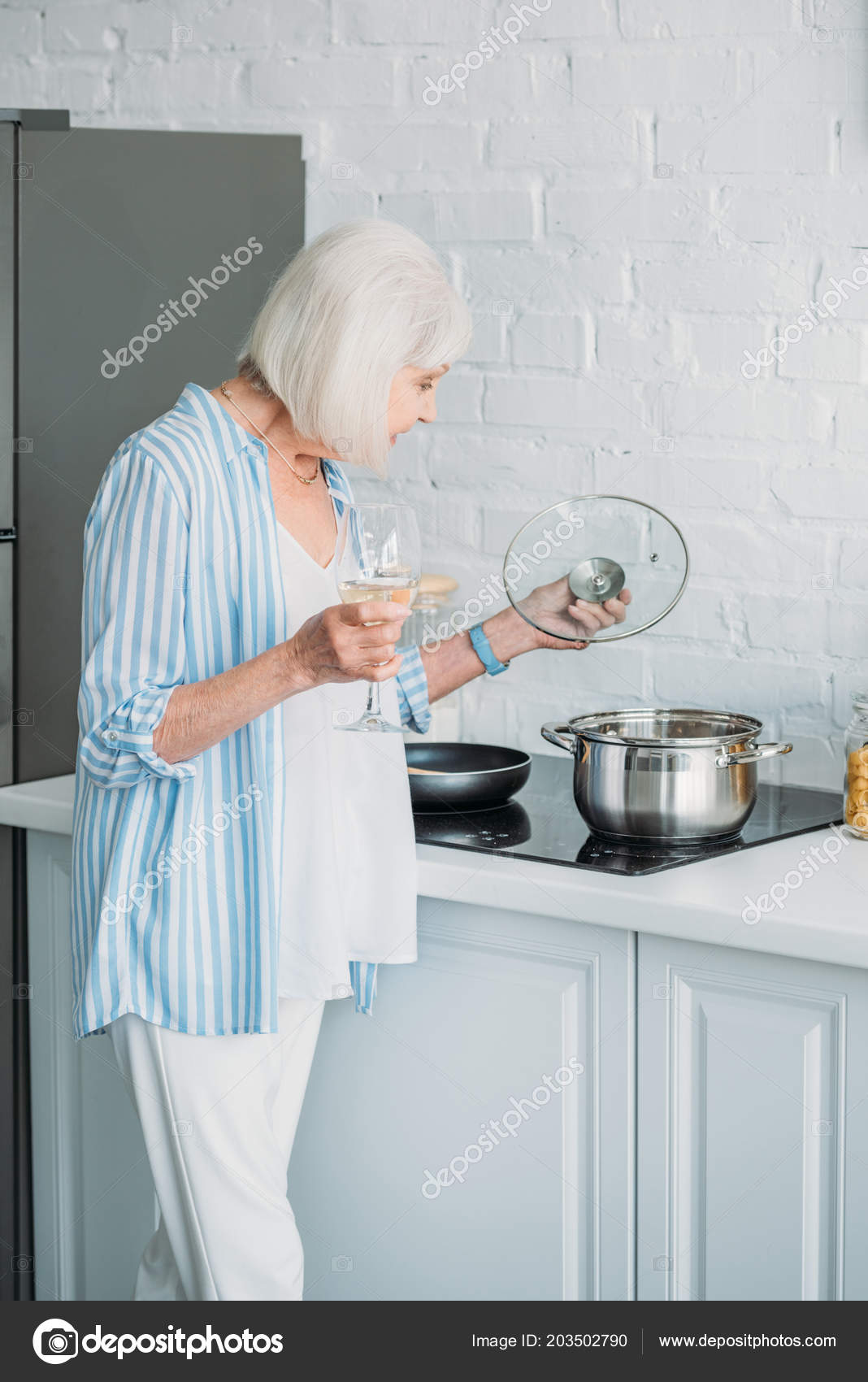 Side View Senior Lady Glass Wine Checking Saucepan Stove Kitchen ...