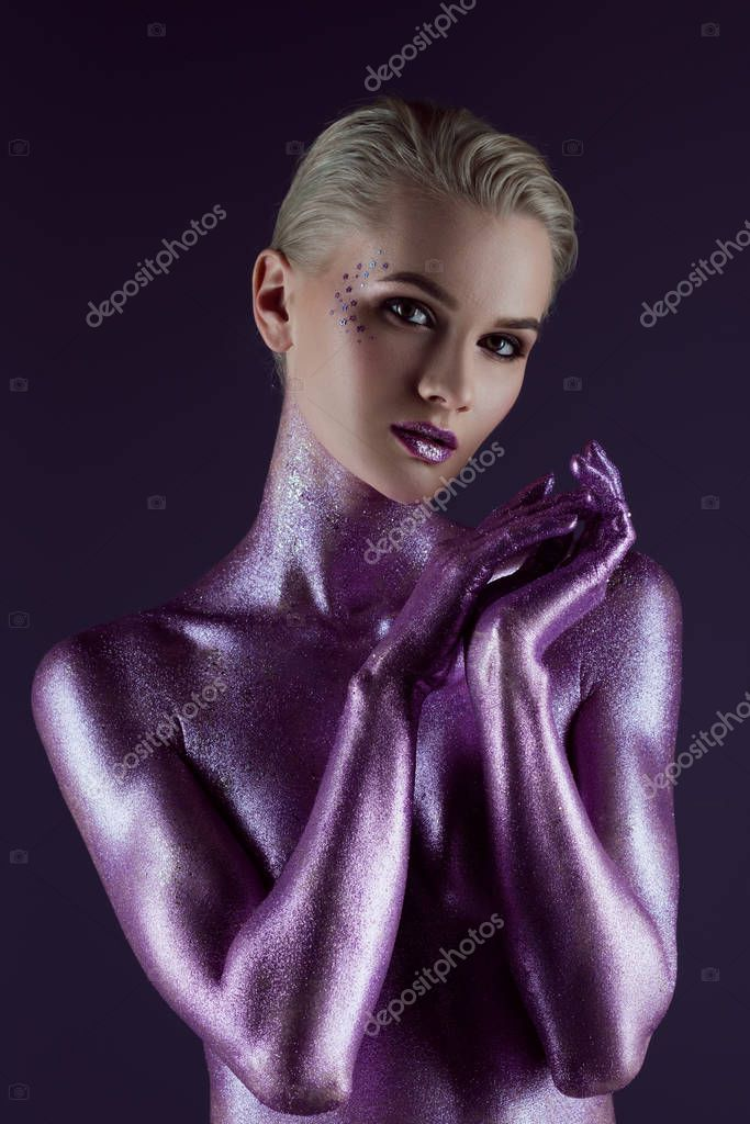 Beautiful fashionable girl posing in ultra violet glitter, isolated on purple stock vector