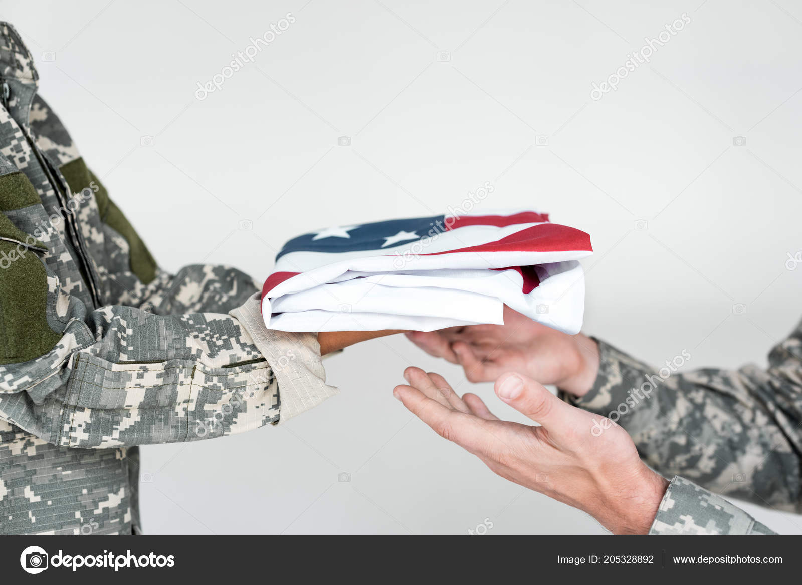 cropped shot kid camouflage clothing giving folded american flag