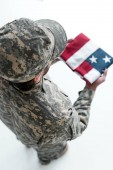 Fotografie overhead view of male soldier in military uniform with american flag in hands