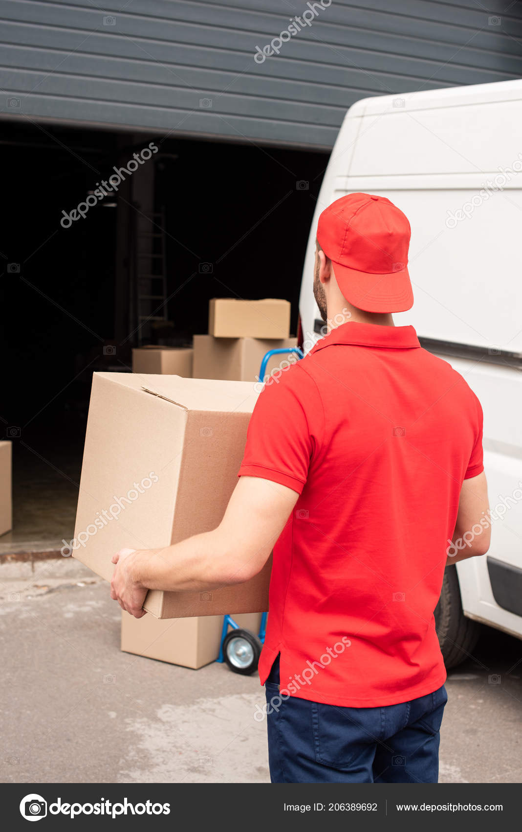 Back View Delivery Man Red Uniform Carrying Cargo — Stock Photo