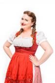 Fotografie attraktive Oktoberfest Kellnerin in traditionellen bayerischen Kleid stehend gestemmt isolierten auf weißen Hintergrund