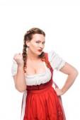 Fotografie ernsthafte Oktoberfest Kellnerin in traditionellen bayerischen Kleid droht durch Faust isoliert auf weißem Hintergrund