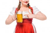 Photo partial view of oktoberfest waitress in traditional bavarian dress pointing by finger on mug of light beer isolated on white background