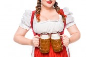 Fotografie cropped image of oktoberfest waitress in traditional bavarian dress showing mugs of light beer isolated on white background
