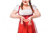 cropped image of oktoberfest waitress in traditional bavarian dress making heart symbol by hands and little pretzel isolated on white background