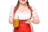 Fotografie cropped image of oktoberfest waitress in traditional bavarian dress showing little pretzels and mug of light beer isolated on white background