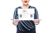 Photo cropped image of female realtor showing maquette of house isolated on white background