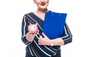 Fotografie cropped image of smiling female accountant with clipboard showing pink piggy bank isolated on white background