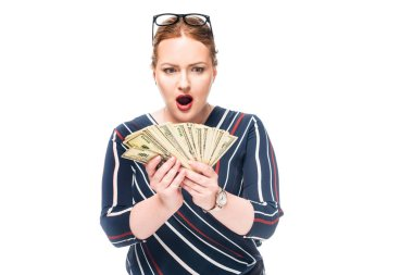 shocked businesswoman looking at dollar banknotes in hands isolated on white background