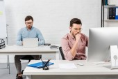 Photo focused businessmen working with computers at modern office