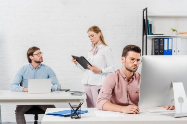 team of executives working together at modern office