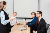 team of business partners having meeting at modern office