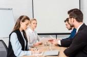 team of business people having meeting at modern office
