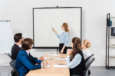 Team of business people listening to conference of their boss stock vector