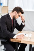 Photo focused young businessman working alone at modern office