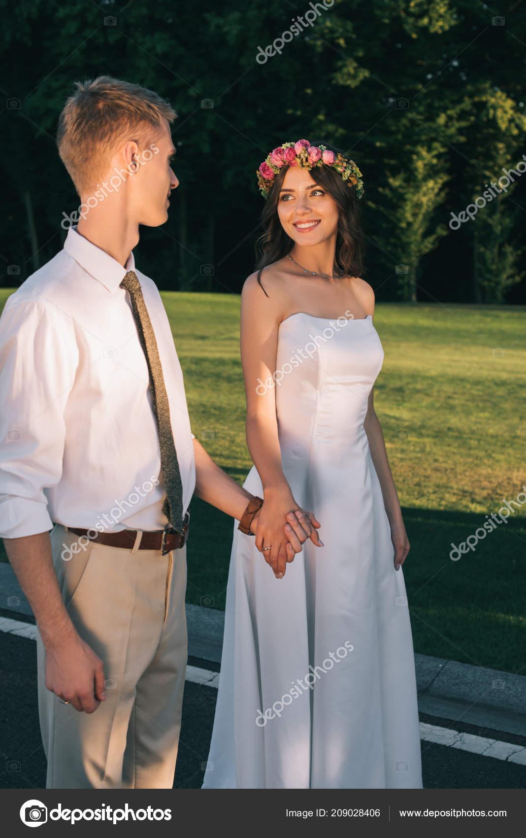 Beautiful Romantic Young Wedding Couple Smiling Each Other Walking Together Stock Photo C Igorvetushko 209028406