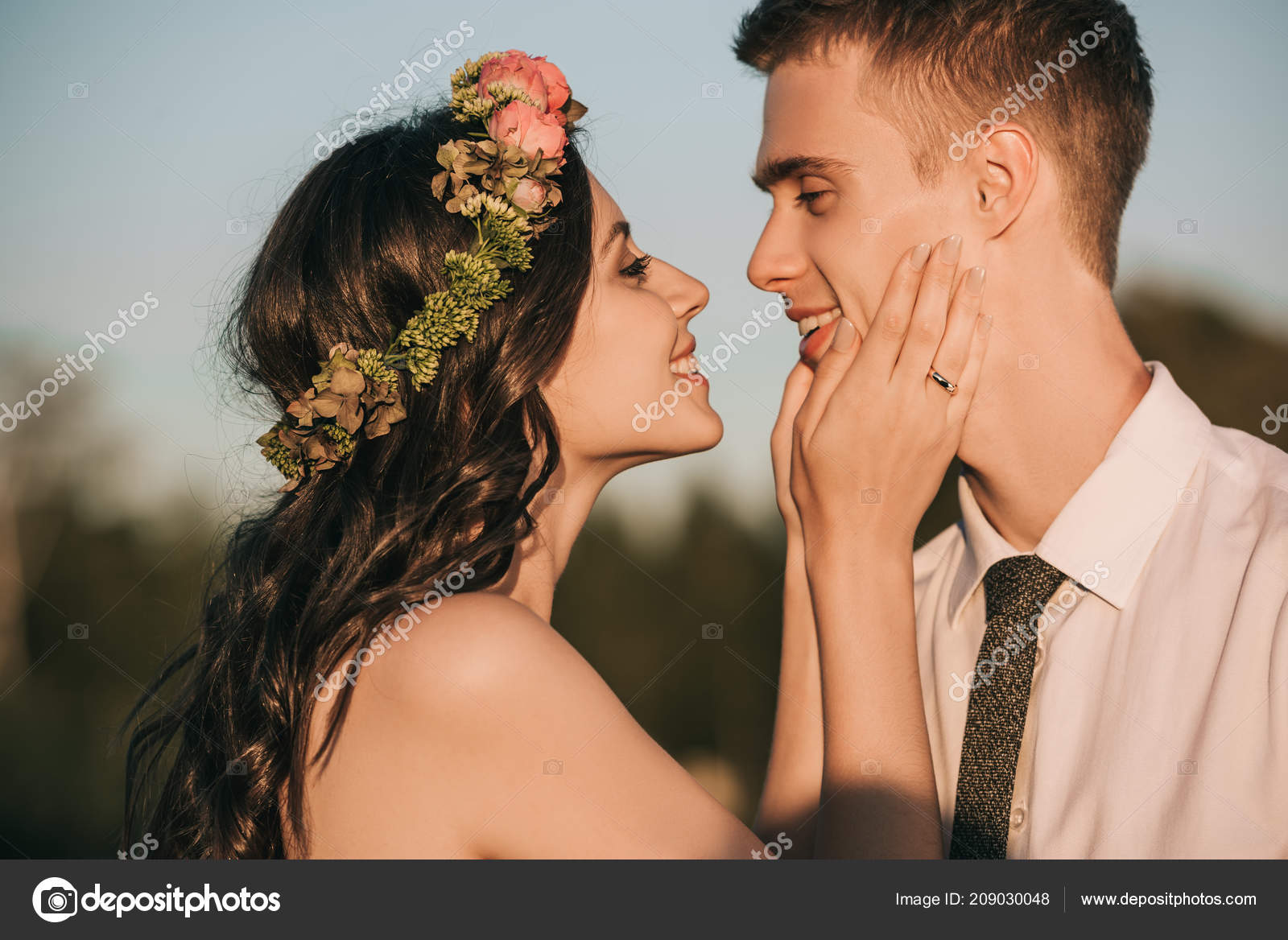 Side View Beautiful Happy Young Wedding Couple Kissing Park Stock Photo by ©IgorVetushko 209030048