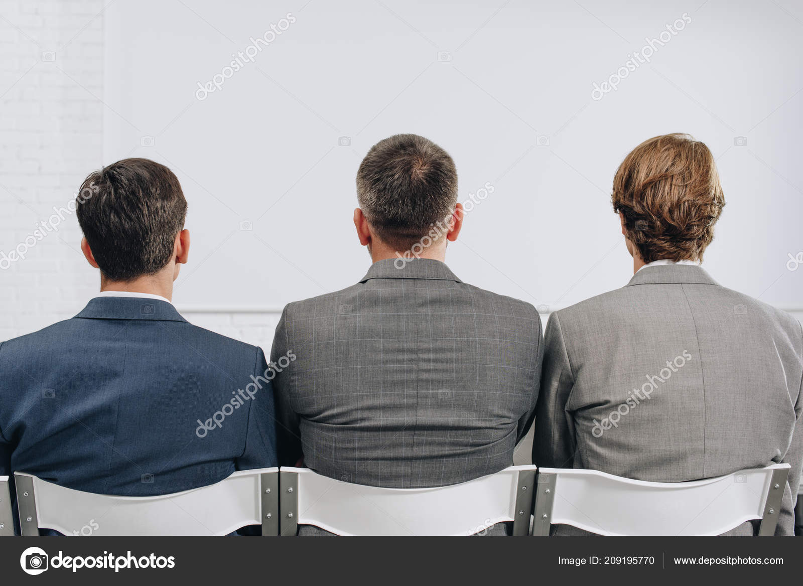back view three businessmen sitting chairs training hub ストック