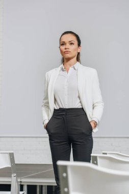 low angle view of attractive serious businesswoman standing in hub