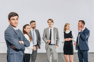 young professional businesspeople standing in hub