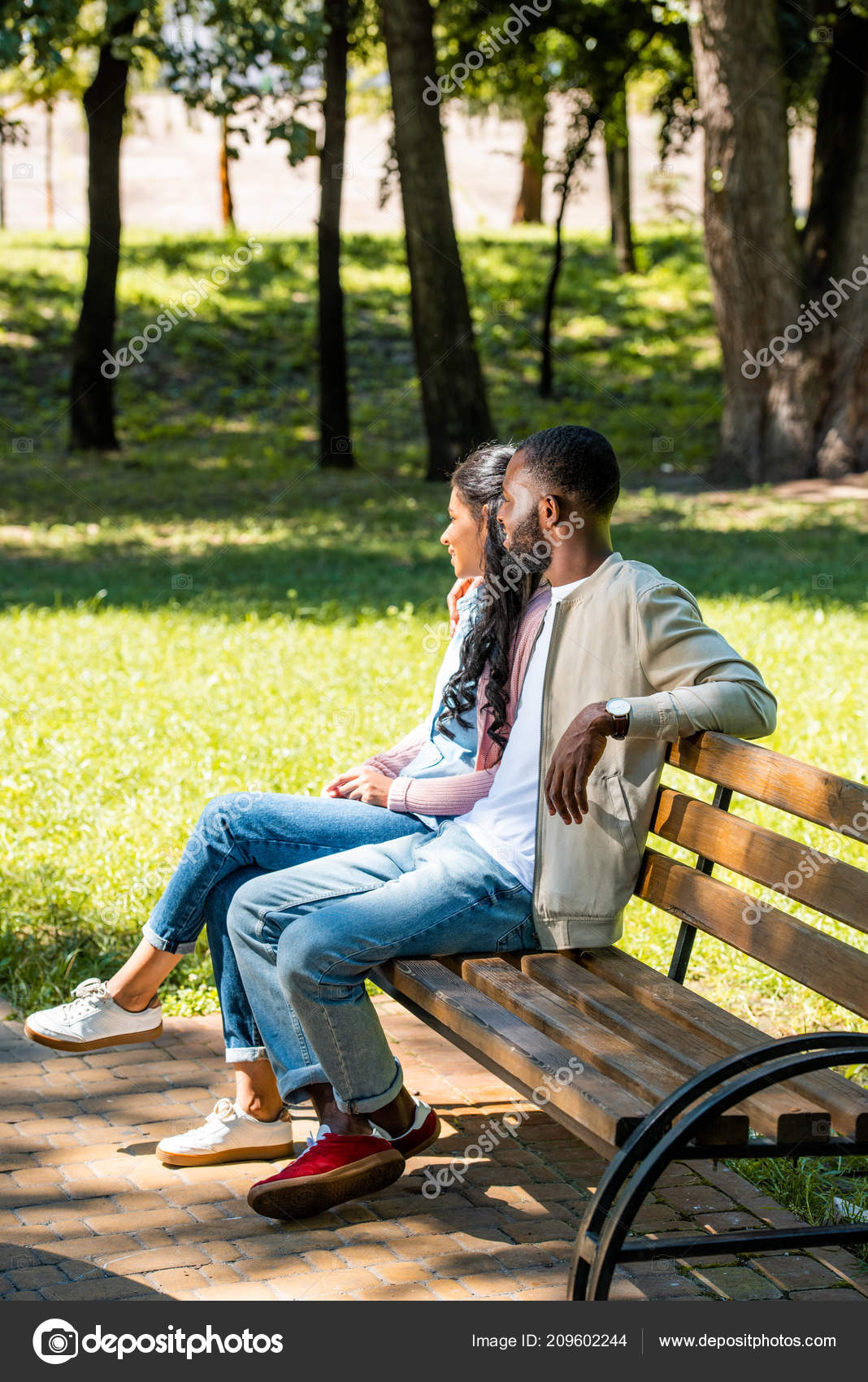 Swell African American Couple Sitting Wooden Bench Park Looking Ocoug Best Dining Table And Chair Ideas Images Ocougorg