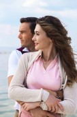 Fotografie portrait of beautiful romantic couple with river on background