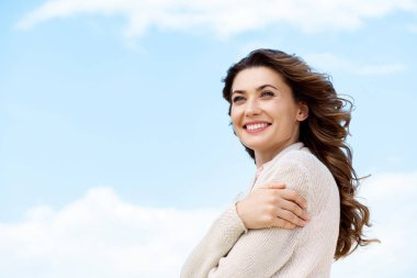 Side view of smiling beautiful woman with blue cloudy sky on background stock vector