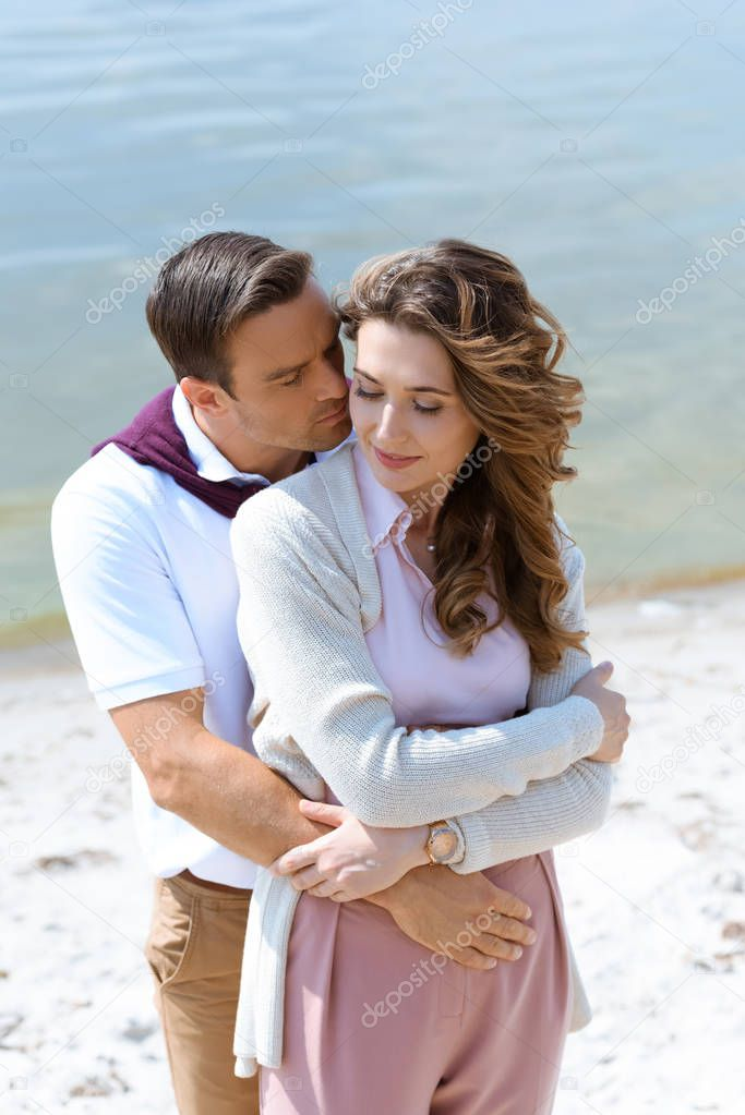 portrait of tender romantic couple with sea on background