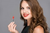 attractive smiling woman with red lipstick isolated on grey