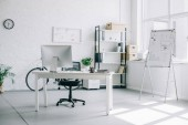 interior of light modern business office with furniture