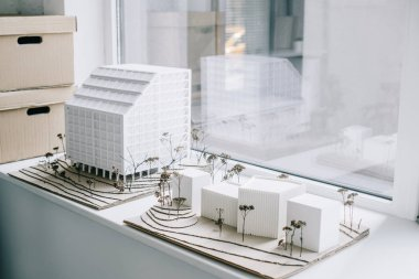 white architecture models on windowsill in light modern office