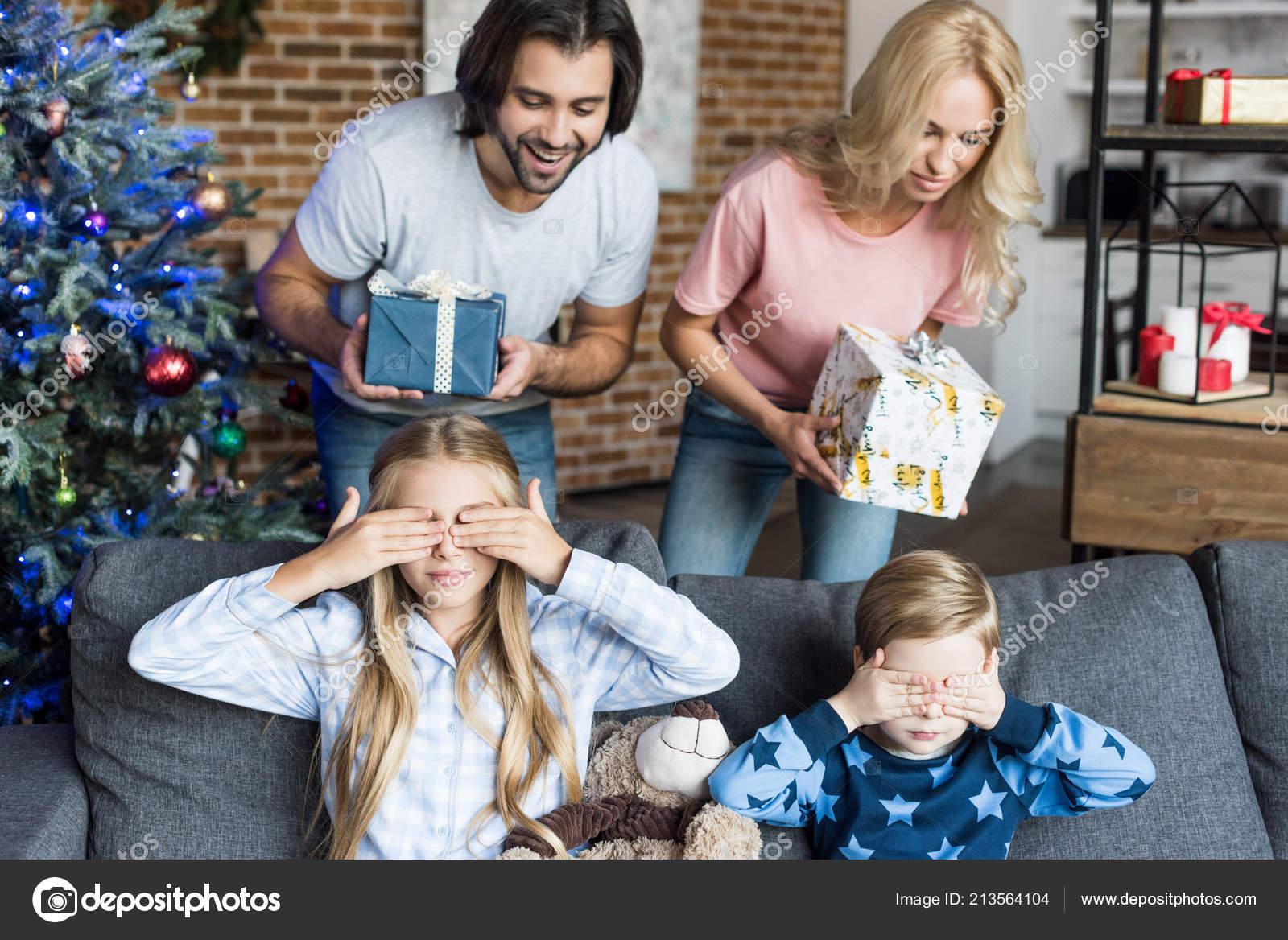 Parents Presenting Christmas Gifts Adorable Children Pajamas Closing ...